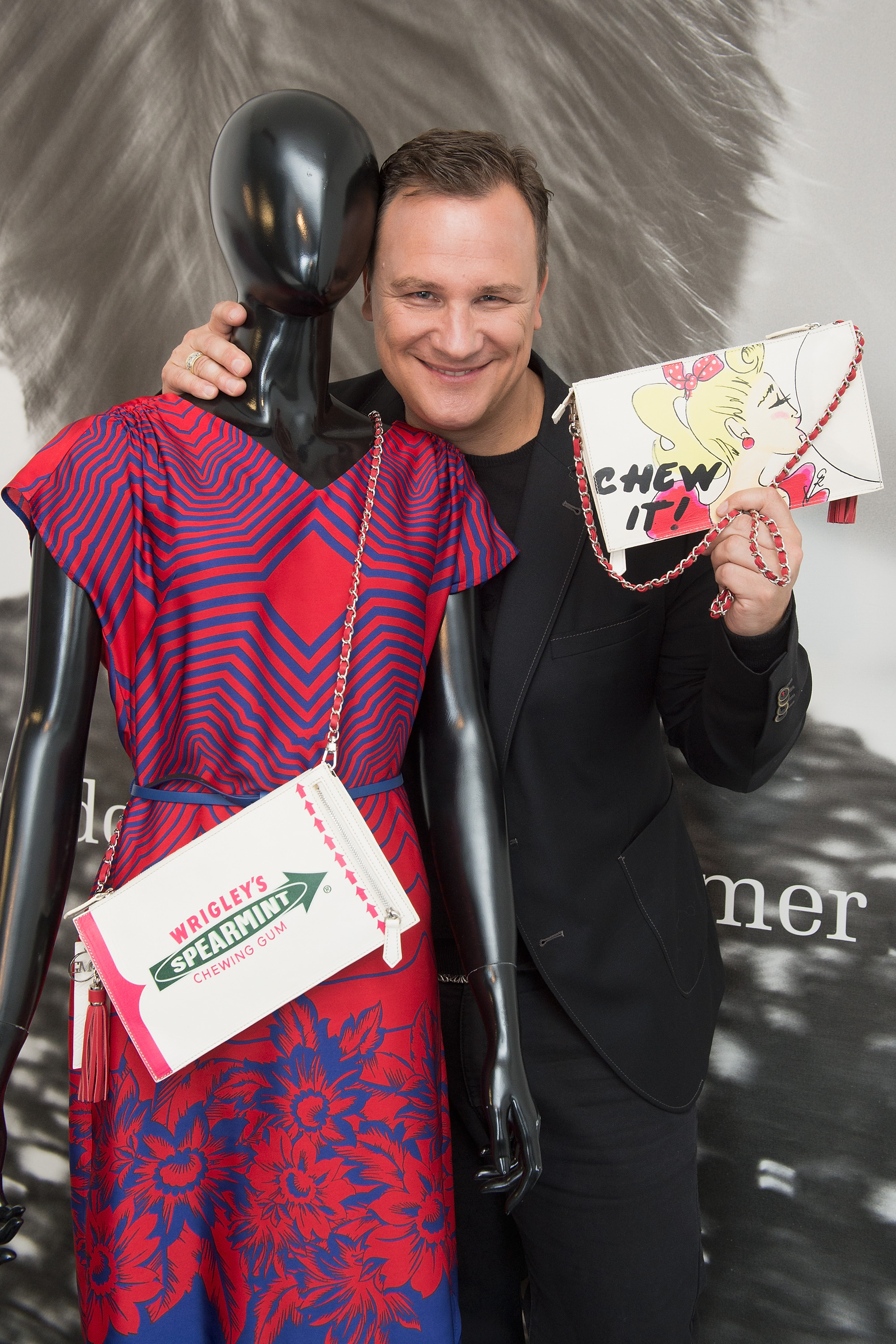 BERLIN, GERMANY - JULY 27:  Guido Maria Kretschmer poses with his newly designed clutch for Wrigley's Spearmint on July 27, 2015 in Berlin, Germany.  (Photo by Matthias Nareyek/Getty Images for Wrigley's Spearmint) *** Local Caption *** Guido Maria Kretschmer