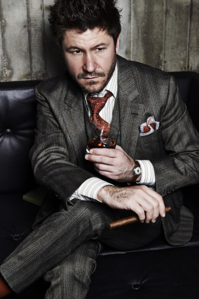 Justin Leone in a suit by Alexander (Savile Row)