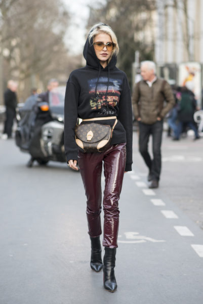 Caro Daur: trousers by Dior, bag by Louis Vuitton and hoodie by Balenciaga