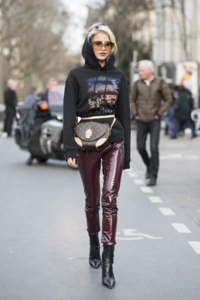 Caro Daur: trousers by Dior, bag by Louis Vuitton and hoodie by Balenciaga