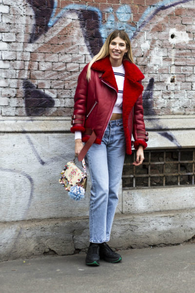 Veronika Heilbrunner (hey-woman.com) in a red sheepskin coat by Acne. The bag is by Fendi and the shoes by Eytys.